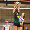 Winnacunnet's Olivia Edwards jumps and spikes the ball while Bishop Guertin's #5 Margaret Richardson puts both hands up to block it during Wednesday Night's Girls Division I Volleyball game between Winnacunnet and Bishop Guertin High Schools @ WHS  on 10-22-2014.  Matt Parker Photo