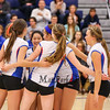 Winnacunnet players celebrate after getting a point on Senior Night during Wednesday Night's Girls Division I Volleyball game between Winnacunnet and Bishop Guertin High Schools @ WHS  on 10-22-2014.  Matt Parker Photo