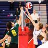 Winnacunnet's Olivia Edwards and Jill Rabasco jump to reach a net ball during Wednesday Night's Girls Division I Volleyball game between Winnacunnet and Bishop Guertin High Schools @ WHS  on 10-22-2014.  Matt Parker Photo