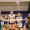 Winnacunnet's Meera McCarthy gets ready to set the ball while her teammates look on during Wednesday Night's Girls Division I Volleyball game between Winnacunnet and Bishop Guertin High Schools @ WHS  on 10-22-2014.  Matt Parker Photo