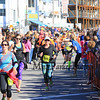 Runners head down the final leg as fans cheer them on at the Smuttynose 2014 Rockfest Half Marathon at Hampton Beach, NH on Sunday 10-5-2014.  Matt Parker Photo