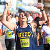 #4392 Billy Valentino of Buchanan NY holds his arms in celebration after finishing the 2014 Smuttynose Rockfest Half Marathon at Hampton Beach, NH on Sunday 10-5-2014.  Matt Parker Photo