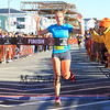 #1360 Saeger Fischer of Porstmouth NH finishes 1st in the womens division at the 2014 Smuttynose Rockfest Half Marathon at Hampton Beach, NH on Sunday 10-5-2014.  Matt Parker Photo