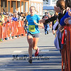 #1360 Saeger Fischer of Porstmouth NH heads into the final meters to finish 1st in the womens division at the 2014 Smuttynose Rockfest Half Marathon at Hampton Beach, NH on Sunday 10-5-2014.  Matt Parker Photo