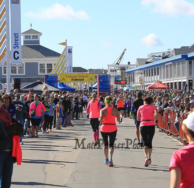 Runners head to the finish line on Hampton Beach's Ocean Bouelvard at the 2014 Smuttynose Rockfest Half Marathon at Hampton Beach, NH on Sunday 10-5-2014.  Matt Parker Photo