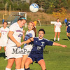 Winnacunnet's Hannah Markowitz heads the ball up the field while Winnacunnet's #3 Isabella Loffredo and  Nashua North's #12 Emily Dion struggle for possession during the Winnacunnet Girls DIV I Varsity Soccer game vs Nashua North  High School on Monday 10-6-2014 @ WHS.  Matt Parker Photo
