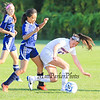Winnacunnet's #17 Jessica Vogel gets pushed by Nashua North's #6 Kianalee Zabala a she tries to shield the ball during the Winnacunnet Girls DIV I Varsity Soccer game vs Nashua North  High School on Monday 10-6-2014 @ WHS.  Matt Parker Photo