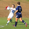 Winnacunnet's Defender Meghan Vogel lines to kick the ball up the field as Nashua North's #12 Emily Dion closes in during the Winnacunnet Girls DIV I Varsity Soccer game vs Nashua North  High School on Monday 10-6-2014 @ WHS.  Matt Parker Photo