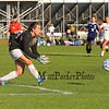 Winnacunnet's Goal Keeper prepares to pick up a kicked ball by a Nashua North player during the Winnacunnet Girls DIV I Varsity Soccer game vs Nashua North  High School on Monday 10-6-2014 @ WHS.  Matt Parker Photo