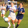 Winnacunnet's Hannah Markowitz keeps possession of the ball while Nashua North's #12 Emily Dion puts the pressure on during the Winnacunnet Girls DIV I Varsity Soccer game vs Nashua North  High School on Monday 10-6-2014 @ WHS.  Matt Parker Photo