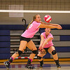 Winnacunnet's #30 Alison Taylor bumps the ball with her arms to the front row while teammate #16 Riley Bibaud backs her up during the Breast Cancer Awareness Pink Night at Winnacunnet Girls Varsity Volley Ball vs Merrimack High School on Wednesday 10-8-2014 @ WHS.  Matt Parker Photo