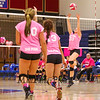 Winnacunnet's Sarah Dyer sets the ball to a teammate during the Breast Cancer Awareness Pink Night at Winnacunnet Girls Varsity Volley Ball vs Merrimack High School on Wednesday 10-8-2014 @ WHS.  Matt Parker Photo