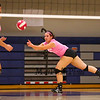 Winnacunnet's #16 Riley Bibaud reaches for a ball during the Breast Cancer Awareness Pink Night at Winnacunnet Girls Varsity Volley Ball vs Merrimack High School on Wednesday 10-8-2014 @ WHS.  Matt Parker Photo