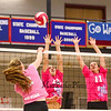 Winnacunnet's Olivia Edwards spikes the ball over the net while Merrimack's #12 Jo coffey and #11 Elise Jolly defend during the Breast Cancer Awareness Pink Night at Winnacunnet Girls Varsity Volley Ball vs Merrimack High School on Wednesday 10-8-2014 @ WHS.  Matt Parker Photo