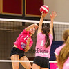 Merrimack's #15 Jen Coffey spikes the ball while Winnacunnet's #14 Meg Knollmeyer defends during the Breast Cancer Awareness Pink Night at Winnacunnet Girls Varsity Volley Ball vs Merrimack High School on Wednesday 10-8-2014 @ WHS.  Matt Parker Photo
