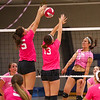 Winnacunnet's Chynna Wan's spike gets blocked by Merrimack's #15 Jen Coffey and #13 Tayla Schipilliti during Wednesday's Breast Cancer Awareness Pink Night at the Girls DIV I Volley Ball game with Winnacunnet vs Merrimack High School  on 10-8-2014 @ WHS.  Matt Parker Photo