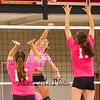 Winnacunnet's Meg Knollmeyer spikes the ball on Merrimack's #16 Katie Flynn and #11 Elise Jolly during the Breast Cancer Awareness Pink Night at Winnacunnet Girls Varsity Volley Ball vs Merrimack High School on Wednesday 10-8-2014 @ WHS.  Matt Parker Photo