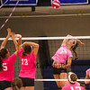 Winnacunnet's Chynna Wan gets ready to spike the ball while Merrimack's #15 Jen Coffey and #13 Tayla Schipilliti look to make a block during Wednesday's Breast Cancer Awareness Pink Night at the Girls DIV I Volley Ball game with Winnacunnet vs Merrimack High School  on 10-8-2014 @ WHS.  Matt Parker Photo