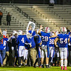 Winnacunnet's players and fans celebrate after the Winnacunnet win at Friday Night's DIV I Football game between the Winnacunnet Warriors  vs Spaulding High School on Friday 10-31-2014 @ WHS.  Matt Parker Photo