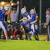 Winnacunnet's #28 Mike Lewis crawls out of the pile and comes up with the football in the end zone for a touchdown while teammates celebrate during Friday Night's DIV I Football game between the Winnacunnet Warriors  vs Spaulding High School on Friday 10-31-2014 @ WHS.  Matt Parker Photo
