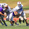 Winnacunnet's Bobby Brown is slowed down by a Nashua South player during Friday's  Football scrimmage between Winnacunnet and Nashua South High Schools @ Winnacunnet on Friday August 29, 2014.  Matt Parker Photo