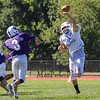 Winnacunnet's Bobby Brown gets his hand up on a thrown ball by Nashua South's Quarterback during Friday's  Football scrimmage between Winnacunnet and Nashua South High Schools @ Winnacunnet on Friday August 29, 2014.  Matt Parker Photo