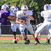 Winnacunnet's Christian LaRosa  uses a nice block on a Nashua South player to get yardage during Friday's  Football scrimmage between Winnacunnet and Nashua South High Schools @ Winnacunnet on Friday August 29, 2014.  Matt Parker Photo