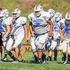 Winnacunnet's Tackle Seth Provencher leads his team back to the Defensive line during Friday's  Football scrimmage between Winnacunnet and Nashua South High Schools @ Winnacunnet on Friday August 29, 2014.  Matt Parker Photo
