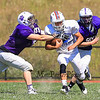 Winnacunnet's Brian Auffant is unable to break free of the Nashua South players during Friday's  Football scrimmage between Winnacunnet and Nashua South High Schools @ Winnacunnet on Friday August 29, 2014.  Matt Parker Photo