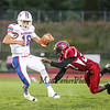 Winnacunnet's Quarterback Brian Auffant is unable to break the grasp of Concord's Daniel Lawrence during Friday Night's Division I Football game between Winnacunnet and Concord High Schools on 9-12-2014.  Matt Parker Photo