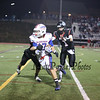 Winnacunnet's Anthony Primavera turns to head down the sideline after making a catch with Bedford's Quarterback #1 Michael Vailas and #20 Tucker Lavigne closing in during Friday Night's Div I Football game Winnacunnet vs Bedford High Schools on 9-19-2014 @ Bedford.  Matt Parker Photo
