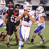 Winnacunnet's Brian Auffant steps up to make a pass during Friday Night's Div I Football game Winnacunnet vs Bedford High Schools on 9-19-2014 @ Bedford.  Matt Parker Photo