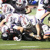 Winnacunnet players pile up on Bedford's #26 Colin Cashin as he gets tackled during Friday Night's Div I Football game Winnacunnet vs Bedford High Schools on 9-19-2014 @ Bedford.  Matt Parker Photo