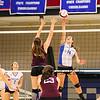 Winnacunnet's #14 Meg Knollmeyer makes a kill shot with Goffstown's #33 Katie Howe defending during Monday's Div I Girls Volleyball game between Winnacunnet and Goffstown High Schools on 10-19-2015 @ WHS.  Matt Parker Photos