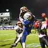 Winnacunnet's #8 Liam Viviano makes a catch with coverage by Timberlane's #34 Austin Hall and during Friday Night's Div I Football game between Winnacunnet and Timberlane High Schools on 10-2-2015 @ WHS.  Matt Parker Photos