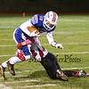 Winnacunnet's #10 James Morse makes a catch and is tackled by Timberlane's #34 Austin Hall during Friday Night's Div I Football game between Winnacunnet and Timberlane High Schools on Friday 10-2-2015 @ WHS.  Matt Parker Photos