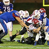 Winnacunnet's #8 Liam Viviano and #73 Seth Provencher tackles Timberlane's Running Back #21 Tyler Furey during Friday Night's Div I Football game between Winnacunnet and Timberlane High Schools on Friday 10-2-2015 @ WHS.  Matt Parker Photos