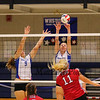 Winnacunnet's #9 Paige Duffy and #4 Saide Gaskell jump to block a kill by Concord's #11 Lauren Hatch during Friday's Div I Girls Volleyball game between Winnacunnet and Concord High Schools on 10-23-2015 @ WHS.  Matt Parker Photos