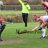 Winnacunnet's #6 Abby Merrill gets low and takes a shot on the Concord goal with Concord Goal Keeper Colleen Casey stepping out to defend during Sunday's Quarterfinal Girls Field Hockey game between Winnacunnet and Concord High Schools on 10-25-2015 @ WHS.  Bryce Parker Photos