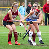 Winnacunnet's #6 Abby Merrill takes a shot with Concord's #19 Emily Otto attempting to block it with her stick and #2 Julia Ek coming in from behind during Sunday's Quarterfinal Girls Field Hockey game between Winnacunnet and Concord High Schools on 10-25-2015 @ WHS.  Bryce Parker Photos