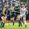 Wildcats #15 Isabel Bretz chases down the ball with Hornets #16 Alana Hartford and #14 Kaitlyn Deblois looking to make a stop during Tuesday's Girls Field Hockey Class B South Championship game between York and Leavitt High Schools @ Fitzpatrick Stadium, Portland, ME on 10-27-2015.  Matt Parker Photos