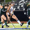York's #29 Lily Posternak stretches to make a play on the ball with Leavitt's #16 Alana Hartford and #26 Alivia Bubier defending during Tuesday's Girls Field Hockey Class B South Championship game between York and Leavitt High Schools @ Fitzpatrick Stadium, Portland, ME on 10-27-2015.  Matt Parker Photos