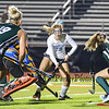 York's #13 Logan Roberge keeps the ball alive as Leavitt's Goal Keeper is drawn out to stop the ball with Leavitt's #19  Chantel Eells and #26 Alivia Bubier defend during Tuesday's Girls Field Hockey Class B South Championship game between York and Leavitt High Schools @ Fitzpatrick Stadium, Portland, ME on 10-27-2015.  Matt Parker Photos