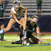 Wildcats #29 Lily Posternak pounces on the ball with Hornets #16 Alana Hartford extending her stick to deflect the ball during Tuesday's Girls Field Hockey Class B South Championship game between York and Leavitt High Schools @ Fitzpatrick Stadium, Portland, ME on 10-27-2015.  Matt Parker Photos