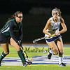 Wildcats #29 Lily Posternak chases down the ball with Hornets #8 Ashley Mathieu defending during Tuesday's Girls Field Hockey Class B South Championship game between York and Leavitt High Schools @ Fitzpatrick Stadium, Portland, ME on 10-27-2015.  Matt Parker Photos