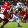 Winnacunnet's #16 Brian Auffant rushes for yards wih Spaulding's #21 Blake Barbin closing in during Friday Night's DIV I Football game between Winnacunnet and Spaulding High Schools on 10-30-2015 @ Spaulding.  Matt Parker Photos