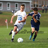 Winnacunnet's #10 Max Chaykowski runs past Titans #4 Jack Gould during Monday's Div I Boys Soccer game between Winnacunnet and Nashua North High Schools on 10-5-2015 @ WHS.  Matt Parker Photos