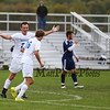 Winnacunnet's #24 Freedy Schaake raises his arms to congratulate  #16 Zach Waterhouse on his goal during Monday's Div I Boys Soccer game between Winnacunnet and Nashua North High Schools WHS-4, Nashua North-2 on 10-5-2015 @ WHS.  Matt Parker Photos