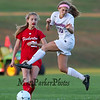 Winnacunnet's #10 Claire Gourgeot jumps to block a kick by Astros #20 Courtney Velho during Wednesday's Div I Girls Soccer game between Winnacunnet High School and Pinkerton Academy on 10-7-2015 @ WHS.  Matt Parker Photos