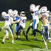Winnacunnet players rush the field after winning Friday Night's DIV I Football game between Winnacunnet and Pinkerton Academy on 10-9-2015 @ Pinkerton.  Matt Parker Photos